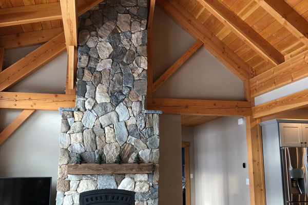 White-Mountain-Timber-Home-Canadian-Timberframes-New-Hampshire-Completed-Great-Room-Fireplace